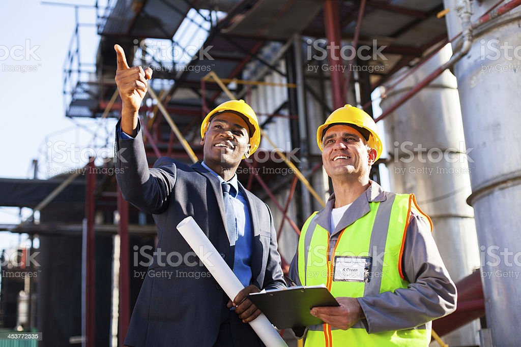 chemical industrial manager and senior worker stock photo