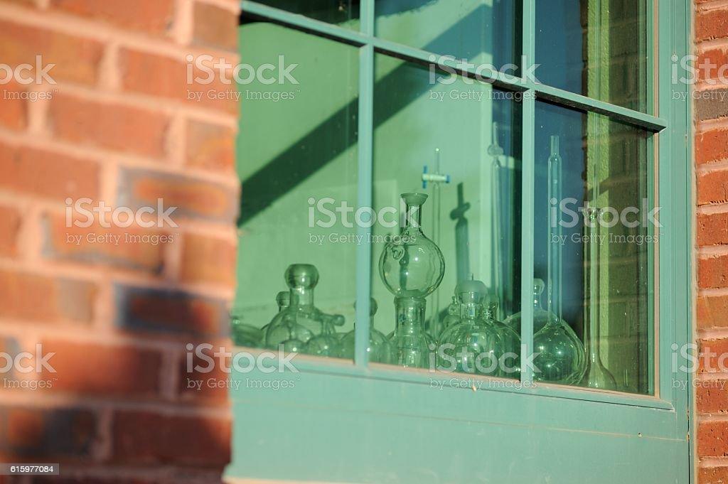 Chemical laboratory glassware in window stock photo