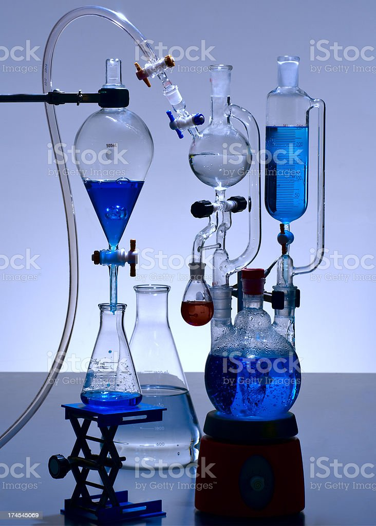 Chemical Laboratory Glassware with Blue Solutions royalty-free stock photo