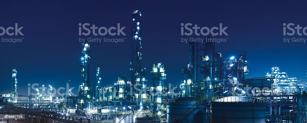 Oil Refinery, chemical & petrochemical plant at night.