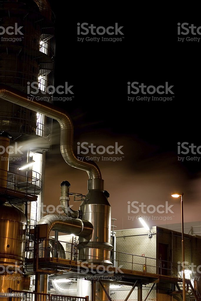 Chemical plant at night with steam royalty-free stock photo
