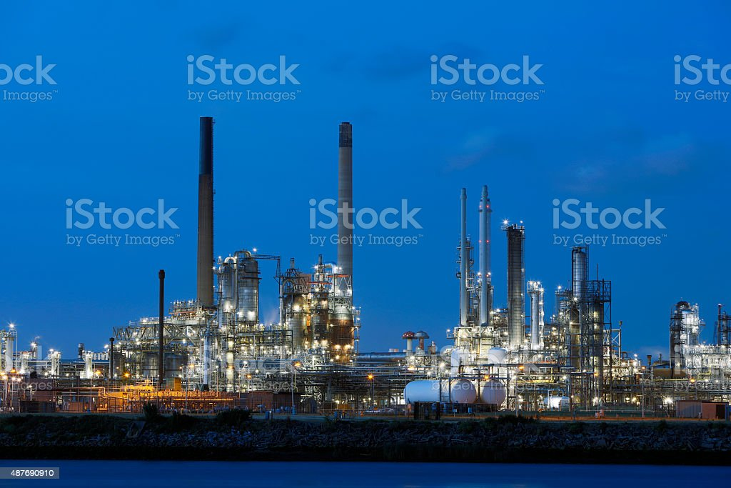 Chemical Plant Illuminated at Dusk in Netherlands stock photo