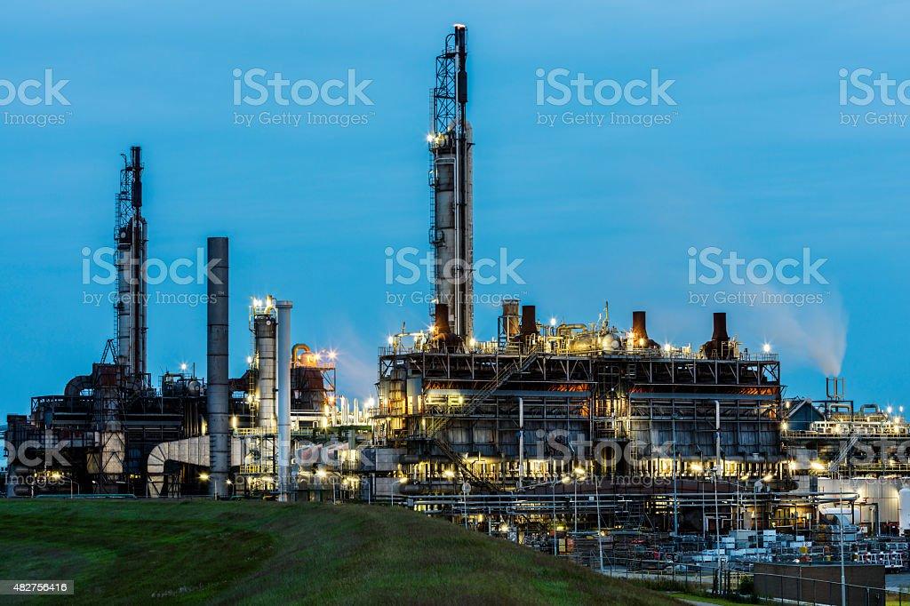 Chemical Plant Illuminated at Dusk stock photo