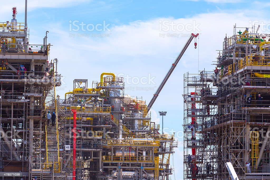 Chemical plant under construction with worker stock photo
