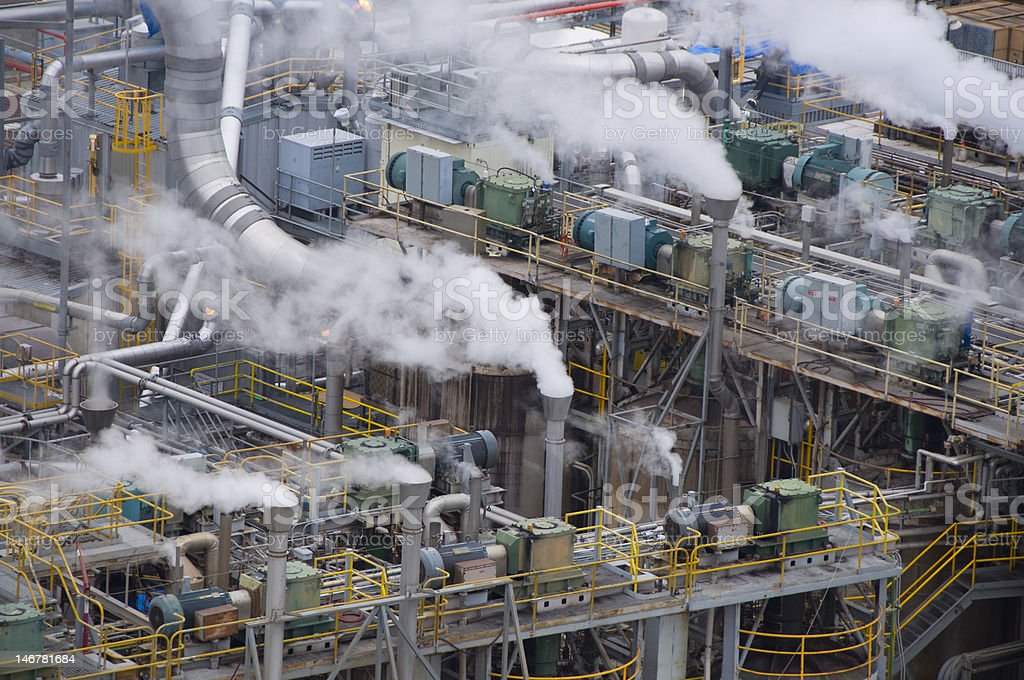 chemical plant with smoke stacks royalty-free stock photo