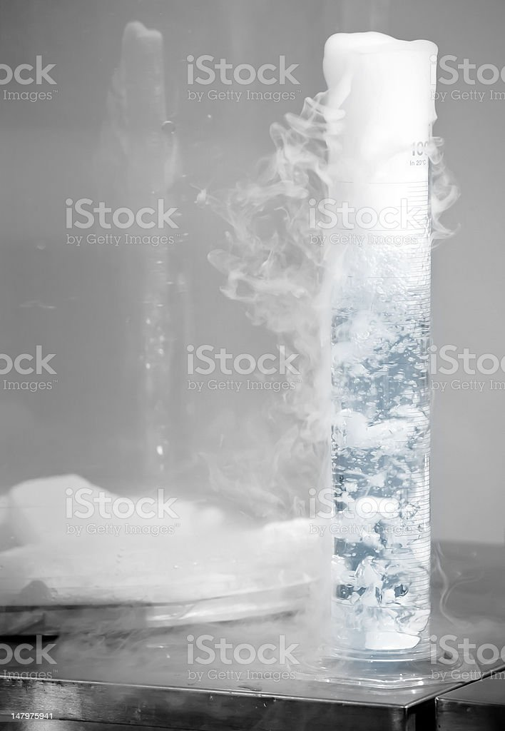Chemical reaction with smoke and bubbles stock photo