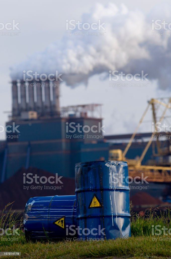 chemical waste drums in front of heavy industry royalty-free stock photo