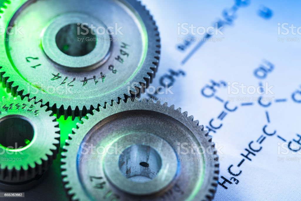 Chemicals reaction formula and mechanical ratchets stock photo