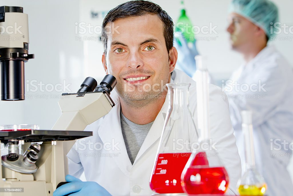 Chemist at a pharmaceutical factory royalty-free stock photo