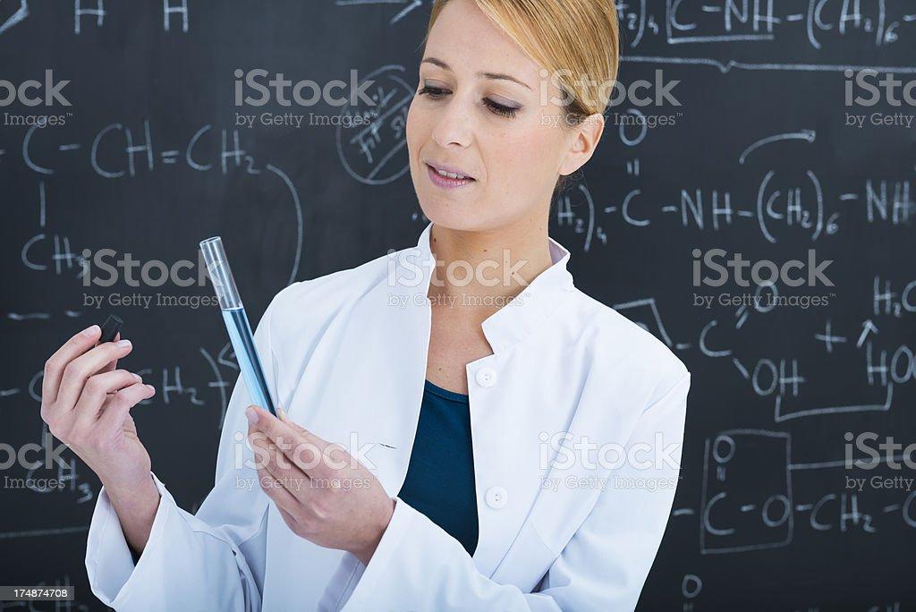 Chemist checking test tube royalty-free stock photo