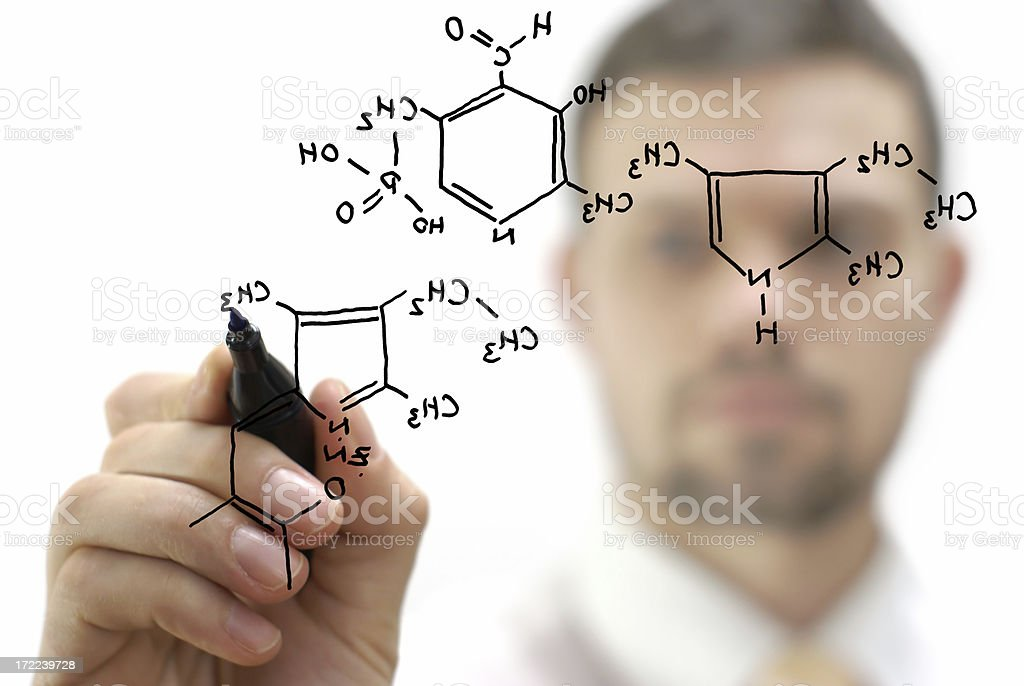 chemist shows a molecular structure royalty-free stock photo