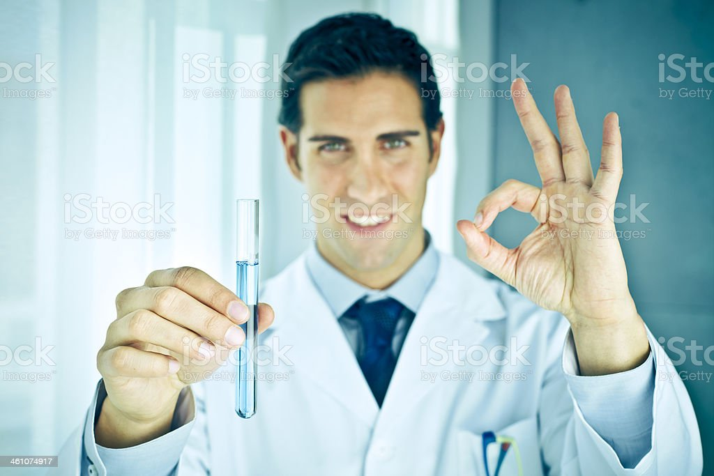 Chemist smelling potion in laboratory royalty-free stock photo