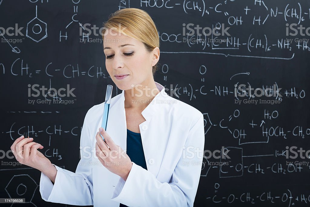Chemist smelling test tube stock photo