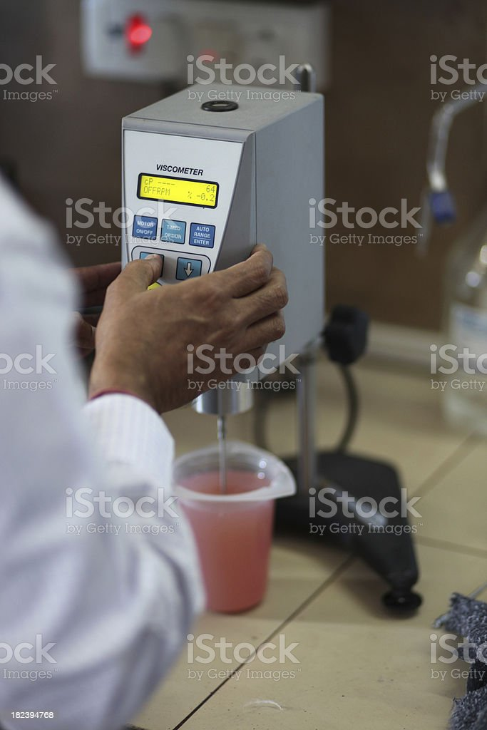Chemist using a viscosimeter royalty-free stock photo