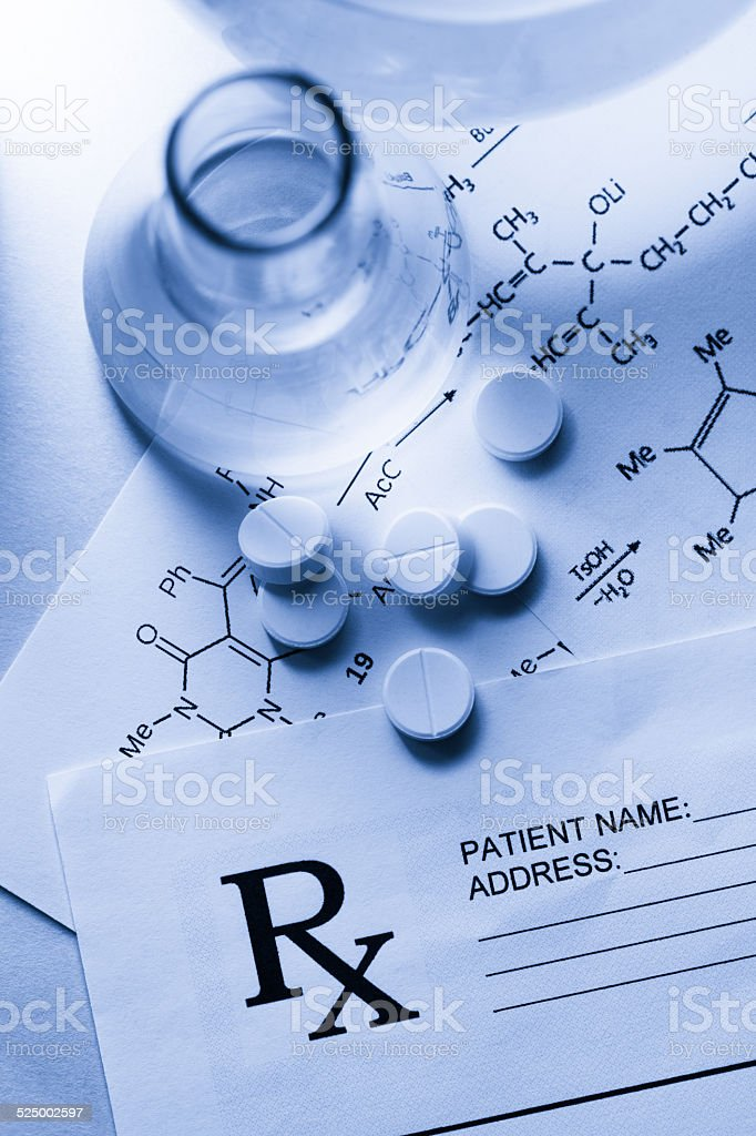 Chemistry and pills stock photo