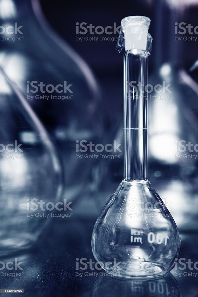 Chemistry flask and other laboratory glassware royalty-free stock photo