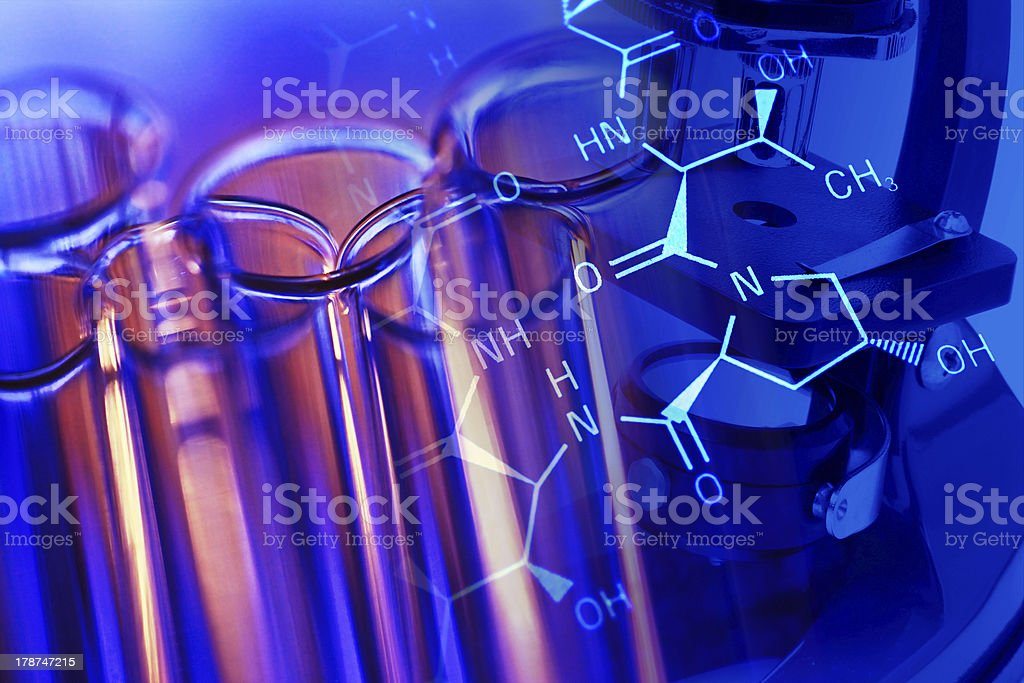 Chemistry science background with microscope and laboratory glass. royalty-free stock photo