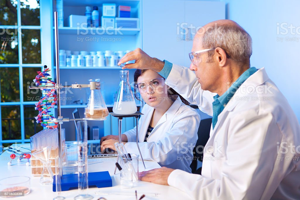 Chemistry Student and Teacher Working in Laboratory stock photo