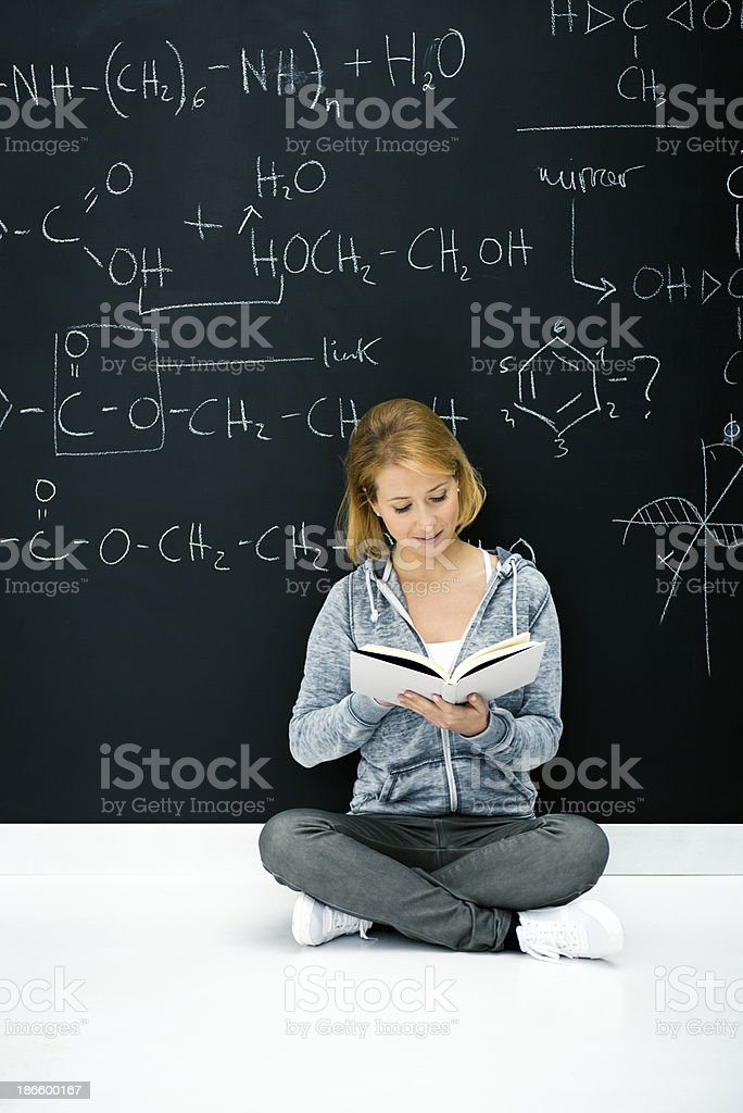 Chemistry student by blackboard royalty-free stock photo