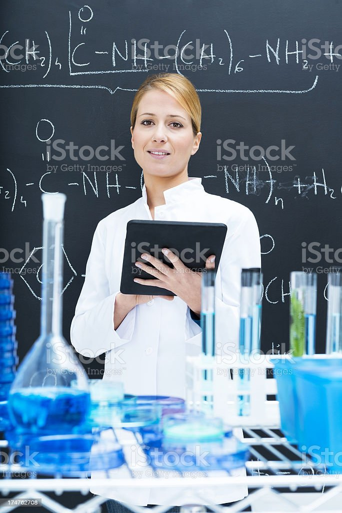Chemistry teacher using tablet royalty-free stock photo