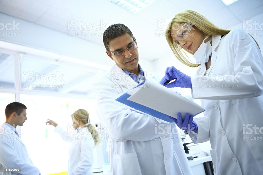 Chemists in a laboratory. stock photo