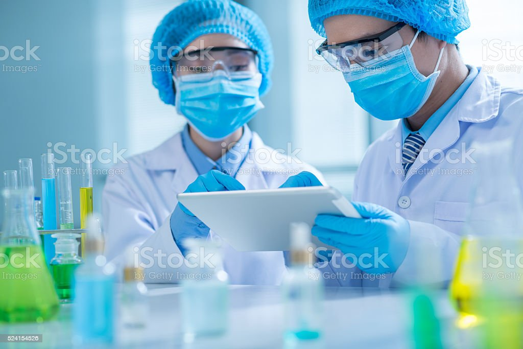 Chemists with tablet computer stock photo