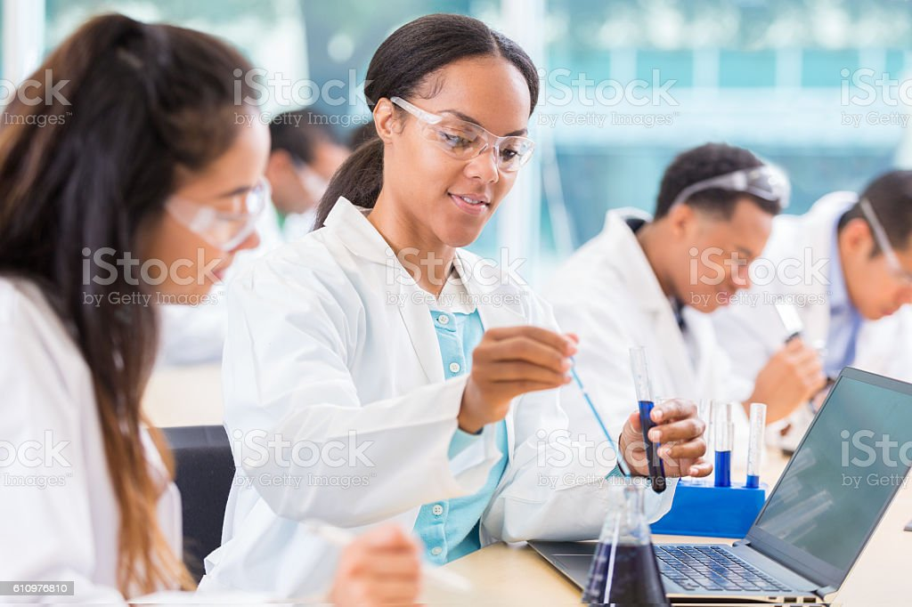 Chemists work on project in lab stock photo