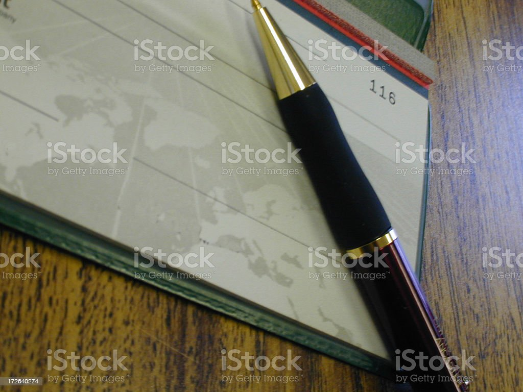 Cheque and pen stock photo