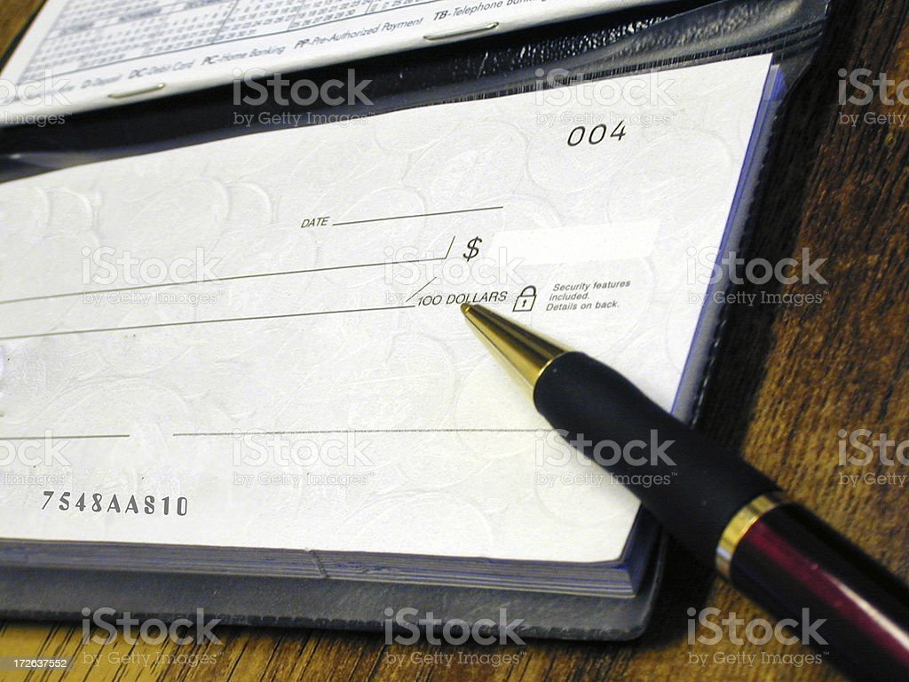 Chequebook & pen stock photo