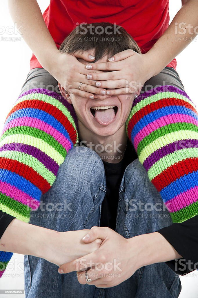 cherfull young man and girl's hands closed him eyes stock photo