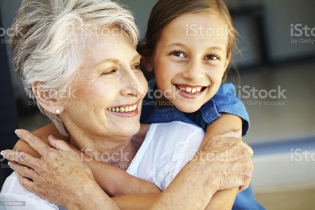 Cherishing her grandmother stock photo