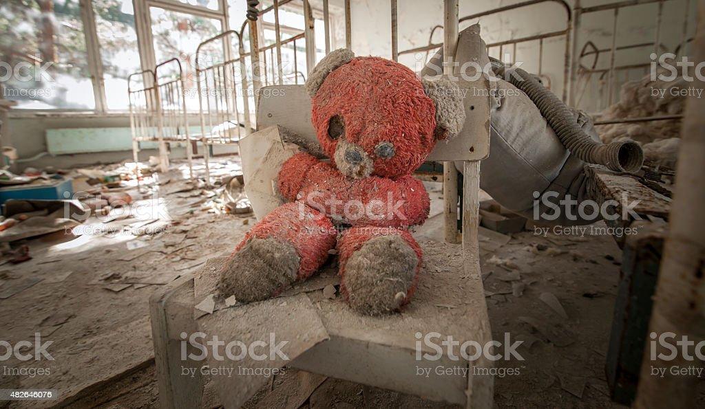 Chernobyl - Teddy bear in abandoned kindergarten stock photo