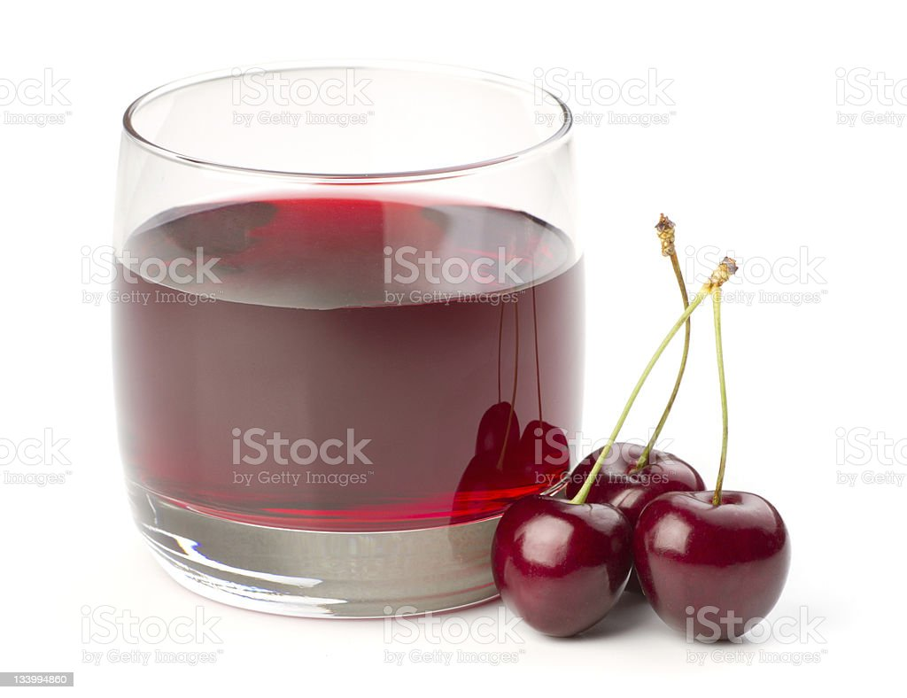 Cherries and a glass of cherry juice isolated on white stock photo