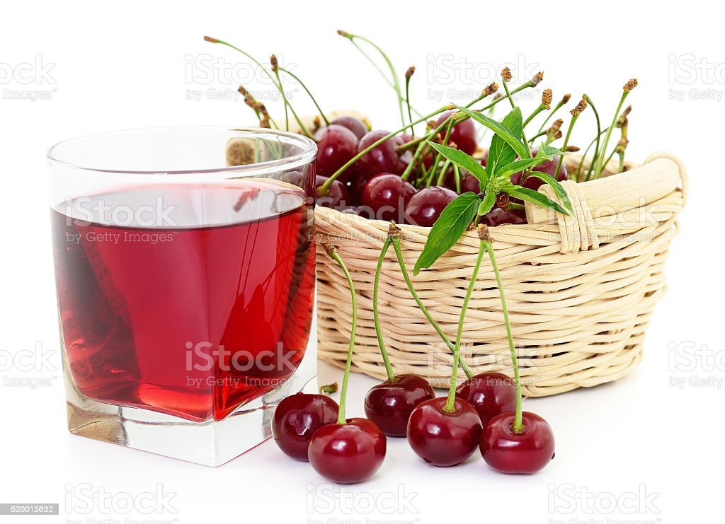 Cherries and a glass of cherry juice stock photo