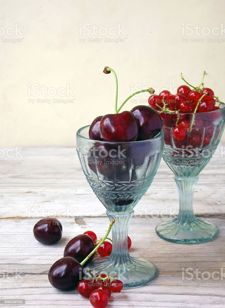 cherries and red currants stock photo