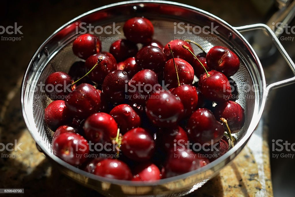 Cherries drying in a colander stock photo