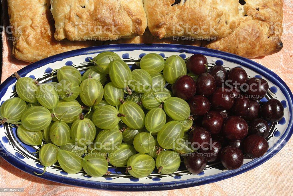 cherries, gooseberries, pies stock photo