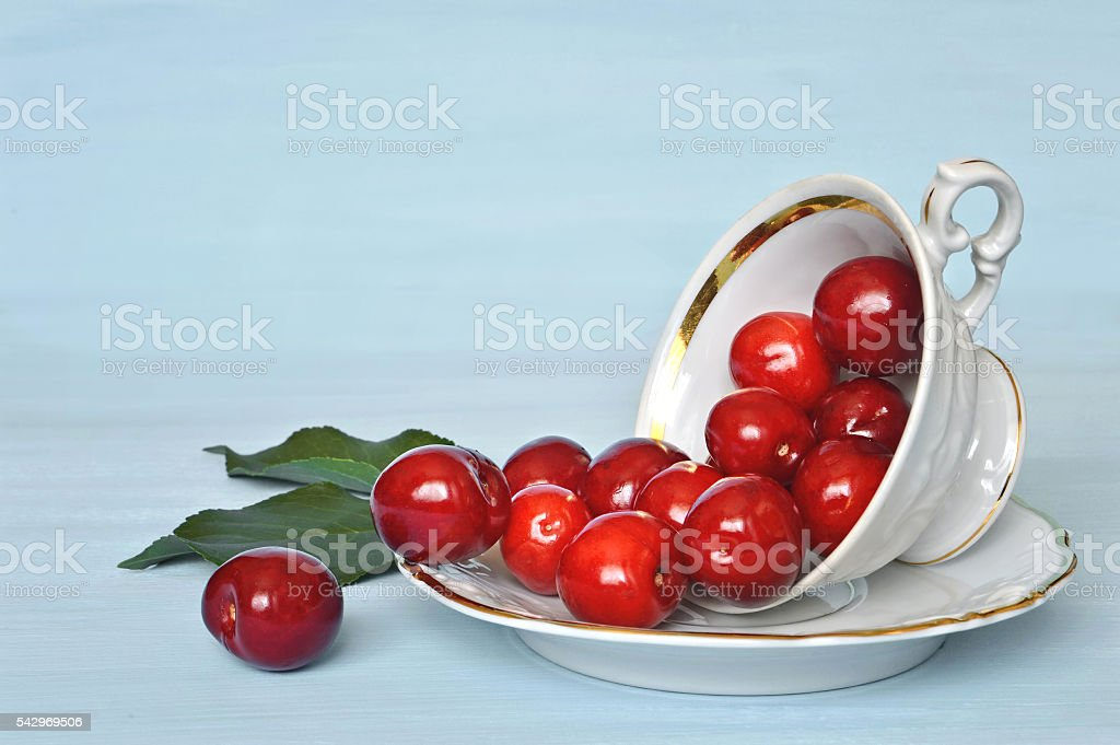 Cherries in a porcelain cup stock photo