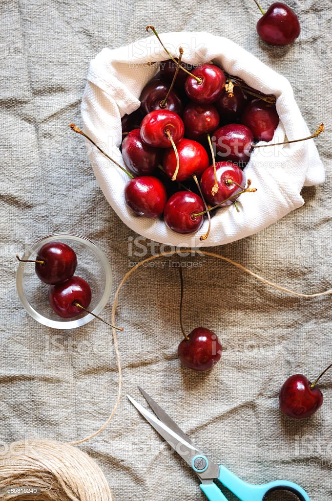 Cherries in linen bag, flat lay stock photo