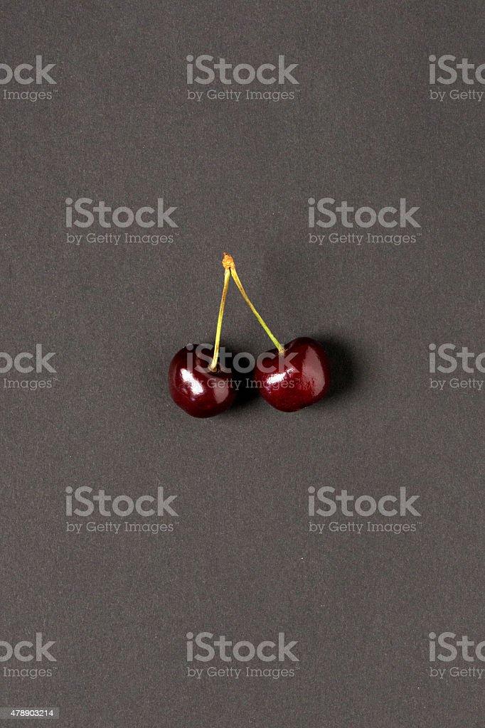 Cherries on dark gray paper stock photo