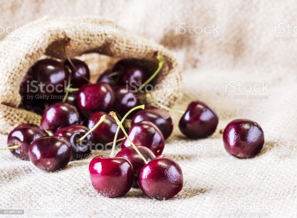 Cherries on the sackcloth stock photo