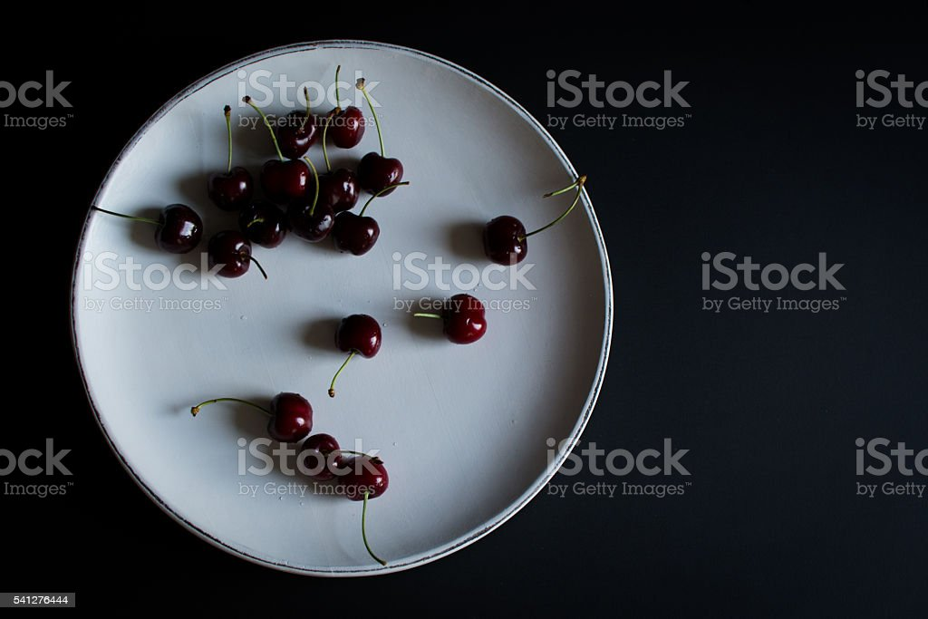 cherries on white with black background from above stock photo