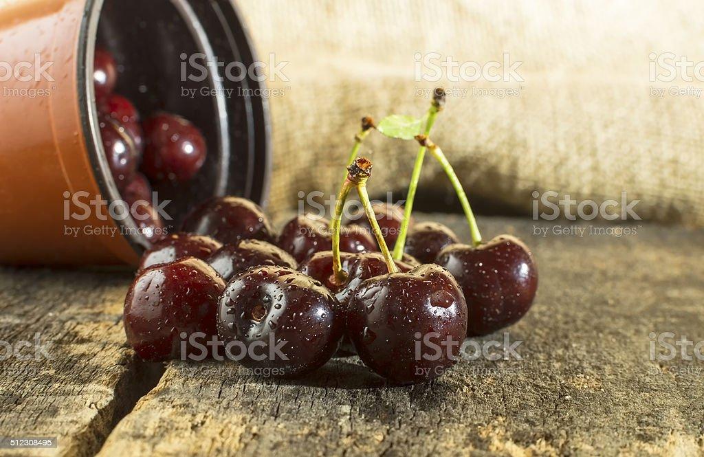 Cherries on wooden table. stock photo