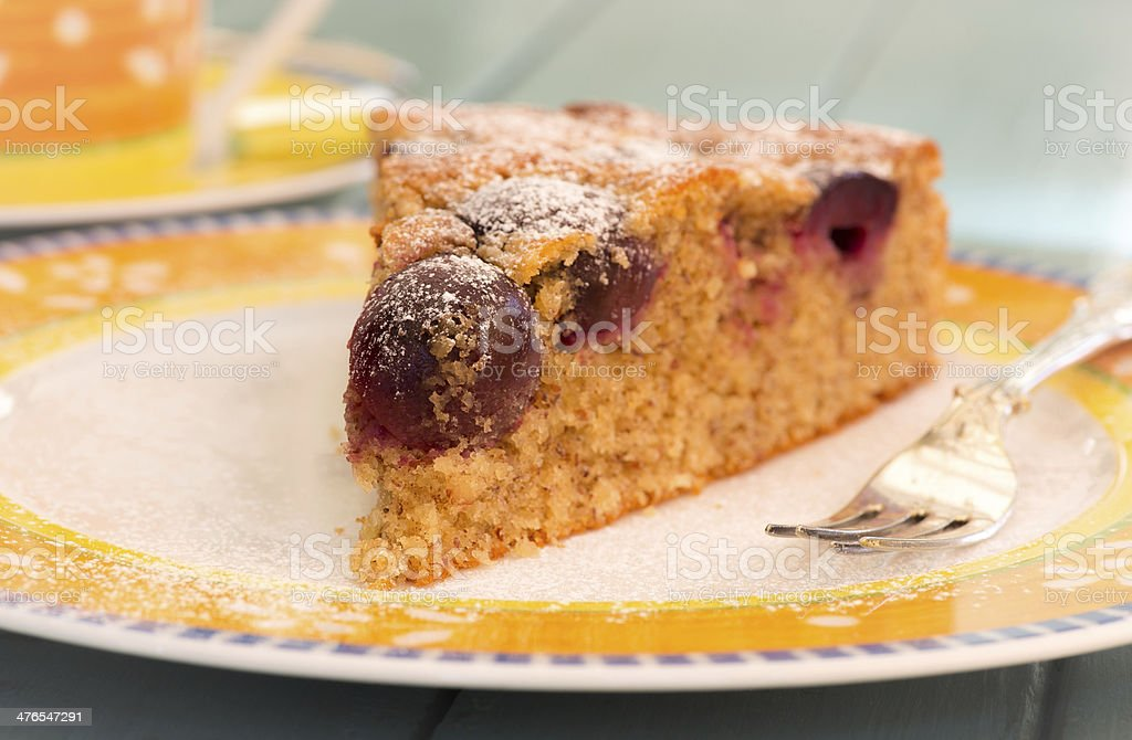 Cherry Almond Cake With Fork on Bright Plate royalty-free stock photo