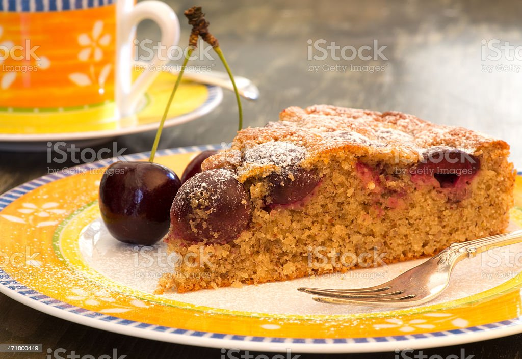 Cherry Almond Cake With Fresh Cherries on Bright Plate royalty-free stock photo