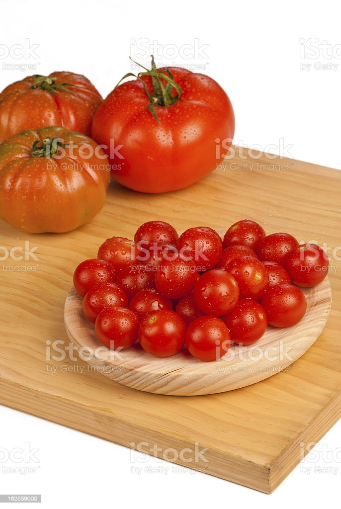 Cherry and  bigger tomatoes royalty-free stock photo