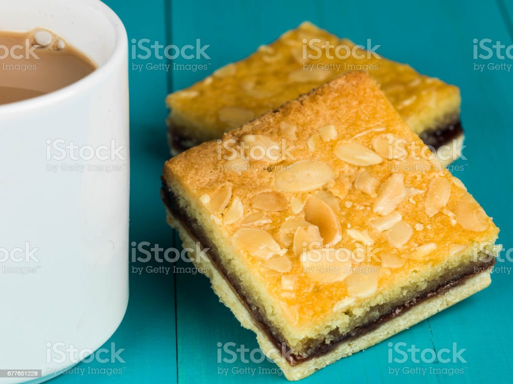 Cherry Bakewell Tarts With a Cup or Mug of Tea or Coffee stock photo