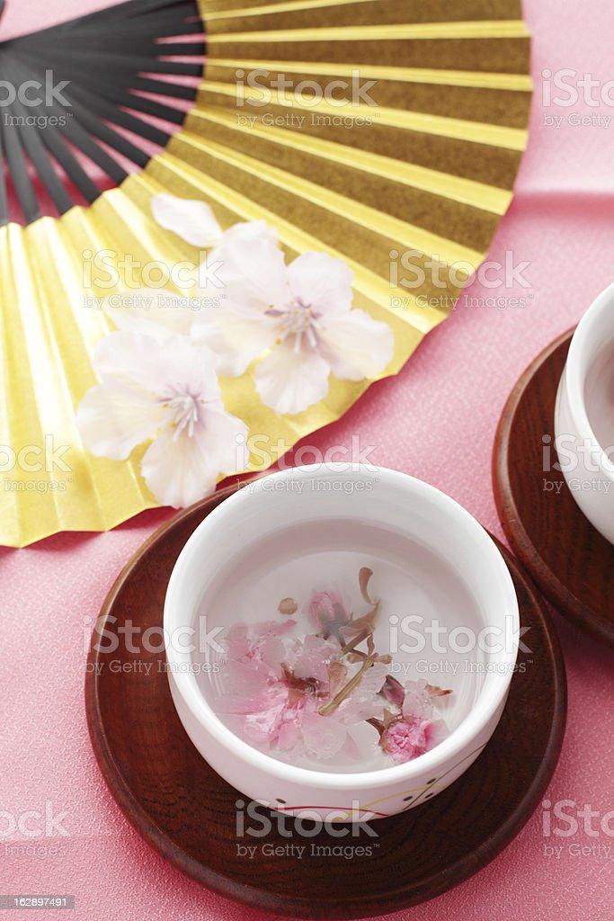 cherry blossom tea and Japanese folding fan royalty-free stock photo
