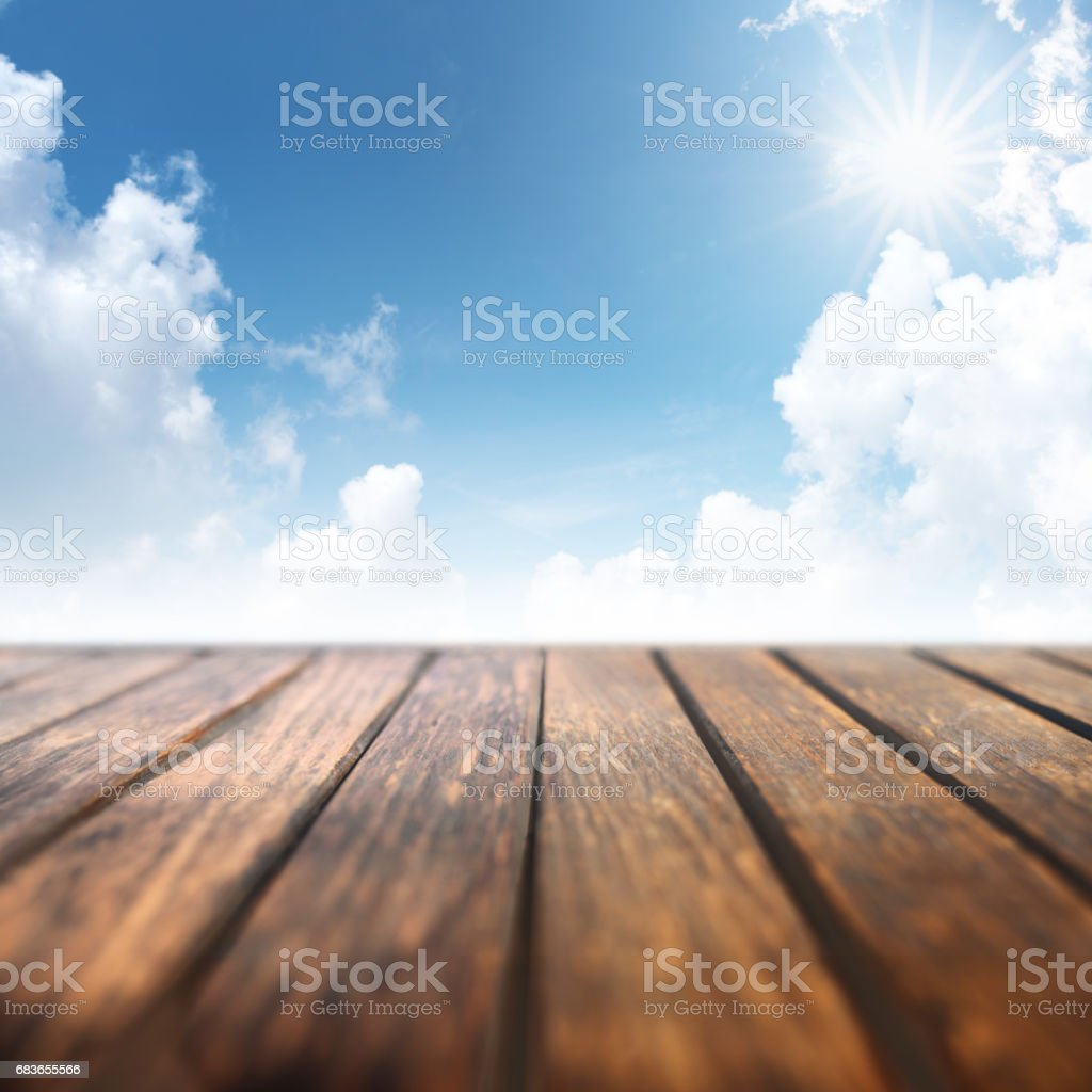 Cherry blossoms in spring with wooden table stock photo
