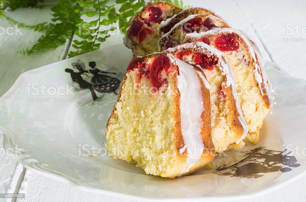 Cherry cake slices on vintage white plate stock photo